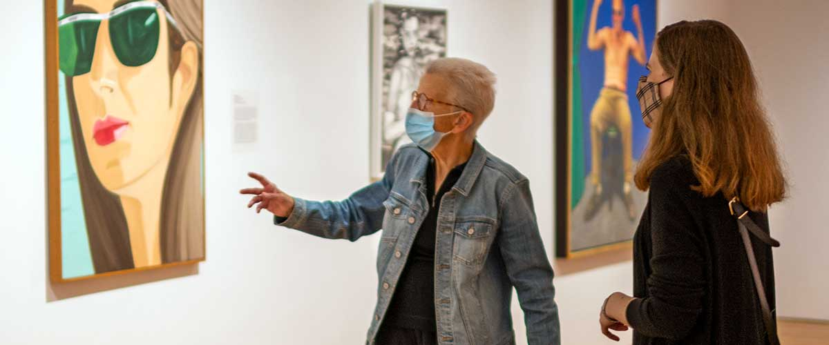 A docent educates a visitor in WAM's 20th-Century gallery